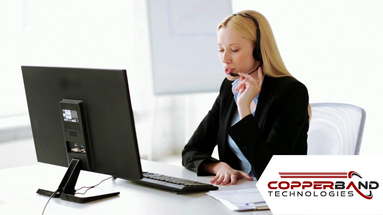Woman with Headset at a computer